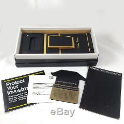 Mint Condition Polaroid SLR 680 withBox and Manual NOS SX70 GOLD Accents