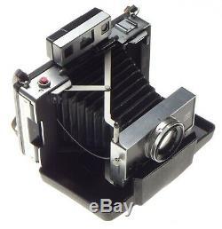 Polaroid 195 Land Instant Film Camera Tomoika Tominon 13.8 f=114mm Lens