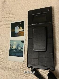 Polaroid SLR 680 Instant Film Land Camera In Good Working Condition (with Film)