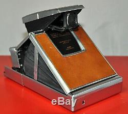 Polaroïd Sx 70 Cuir + Mallette Cuir + 1 Boite Photos Couleurs + 1 Boite N&b