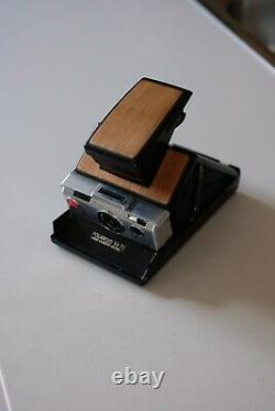 Refurbished SX-70 Folding Instant Polaroid Camera Silver Black and Wooden Panels