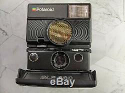 Vintage Polaroid 680 SLR boxed with strap and instruction booklet Rare